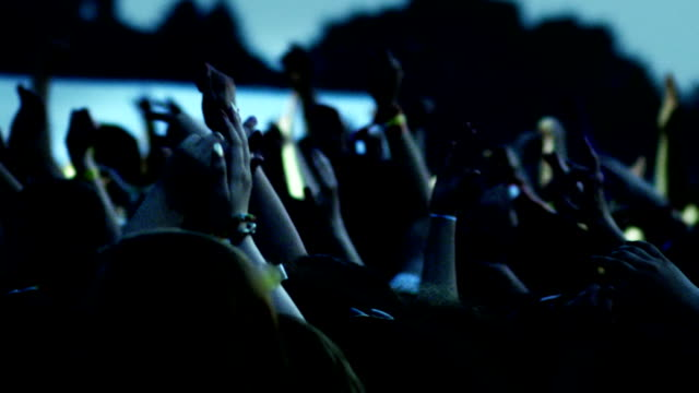 hands in air at concert - crowded stock videos & royalty-free footage