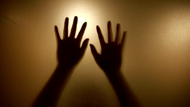 hands in silhouette pressed against frosted glass - trapped stock videos & royalty-free footage