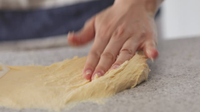 hands kneading bread dough. - dough stock videos and b-roll footage