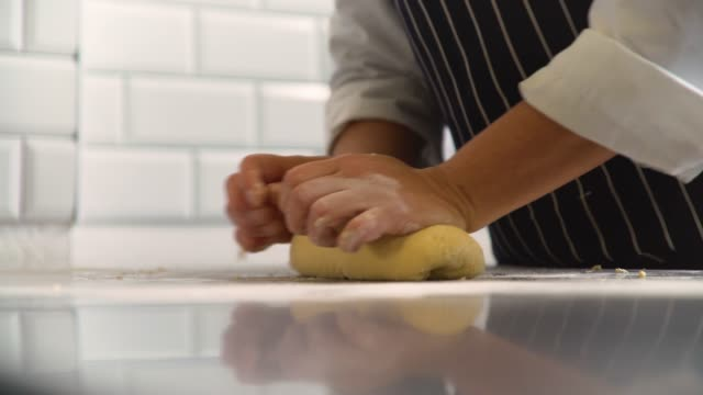 hands kneading pasta dough - apron stock videos & royalty-free footage