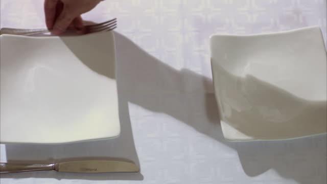 vídeos y material grabado en eventos de stock de hands laying a nice table for two sweden. - menos de diez segundos