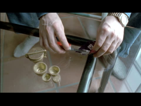 / cu of hands laying out line of cocaine on glass table and of drug being sniffed through straw cocaine use on january 01 1996 in montreal - snorting cocaine stock videos & royalty-free footage
