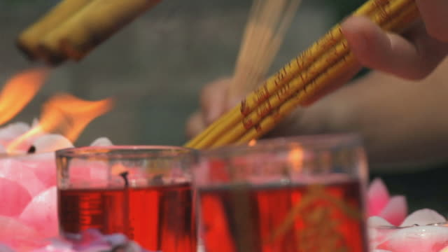 cu r/f hands lighting incense / hangzhou, zhejiang, china - votive candle stock videos and b-roll footage