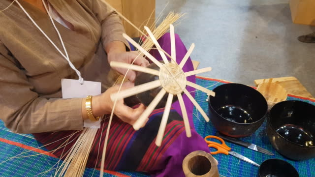 hands making a wicker basket in chiang mai, thailand - caning stock videos and b-roll footage