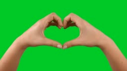 Hands making heart shape on chroma key