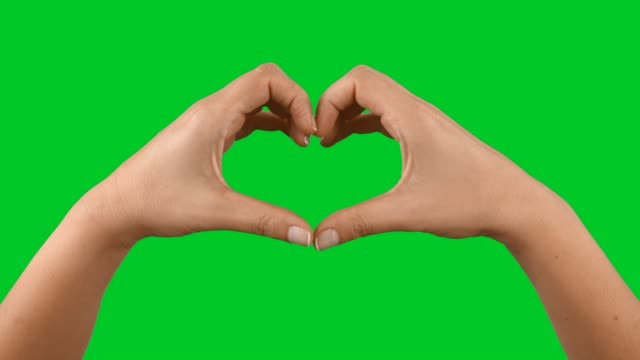 hands making heart shape on chroma key - heart stock videos & royalty-free footage