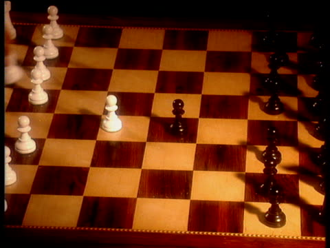 hands making opening moves of game of chess (from 1st black move) - chess stock videos & royalty-free footage