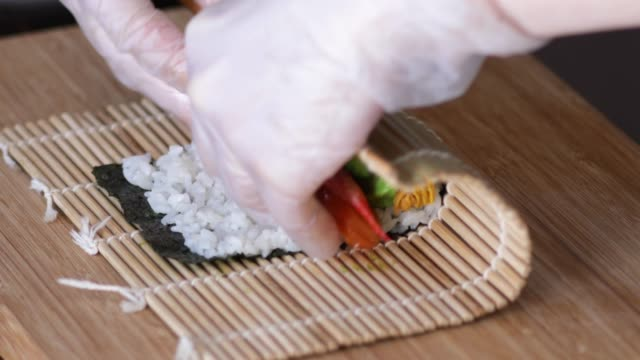 hands making sushi rolls. - shiso stock videos & royalty-free footage