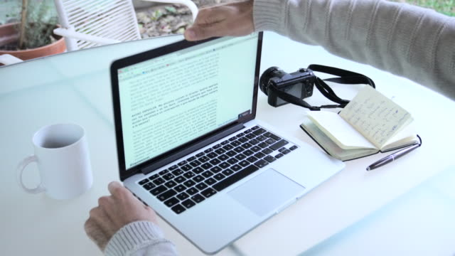 hands man using laptop and writing - laptop stock-videos und b-roll-filmmaterial