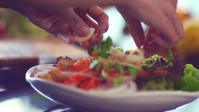 hands mixing vegetables in salad bowl. - lettuce stock videos & royalty-free footage