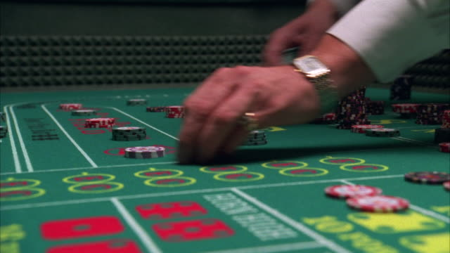 cu hands moving around gambling chips and dice on craps table in casino / las vegas, nevada, usa - gambling chip stock videos and b-roll footage