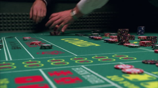 cu hands moving around gambling chips and dice on craps table in casino / las vegas, nevada, usa - craps stock videos & royalty-free footage