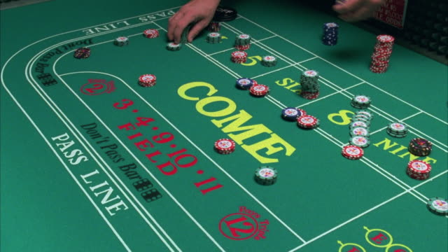 cu hands moving around gambling chips on craps table in casino / las vegas, nevada, usa - gambling chip stock videos and b-roll footage