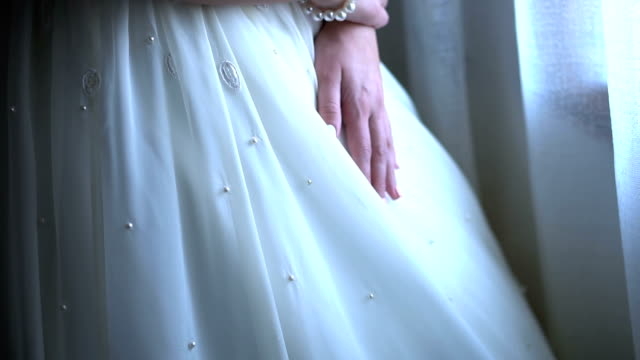 hands of a bride on a wedding dress - white dress stock videos & royalty-free footage