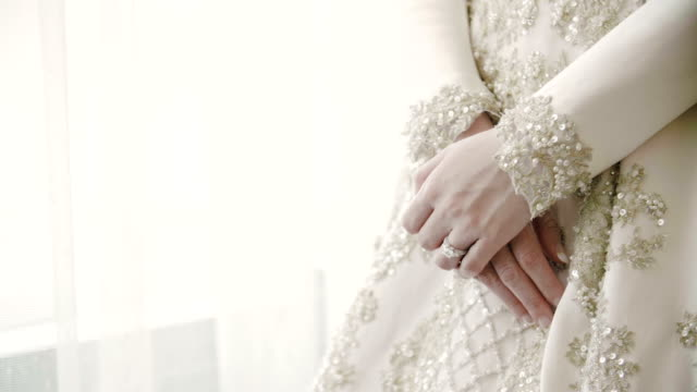Hands of a bride with wedding ring