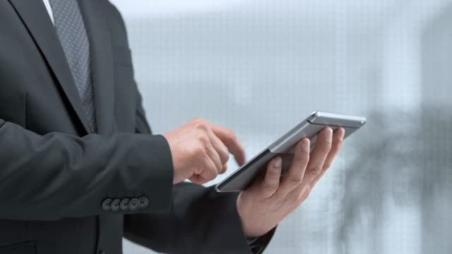 ld hands of a business man scrolling on a tablet - using digital tablet stock videos & royalty-free footage