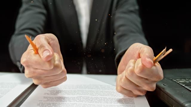 slo mo ld hands of a businessman breaking a pencil - broken pencil stock videos & royalty-free footage