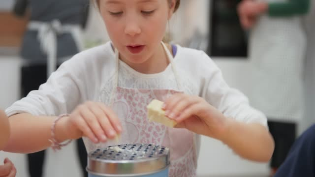 hands of a girl grating cheese - cheese stock videos & royalty-free footage