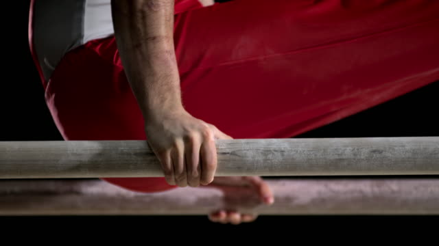 slo mo hands of a gymnast during his routine on parallel bars - gymnastics bar stock videos & royalty-free footage