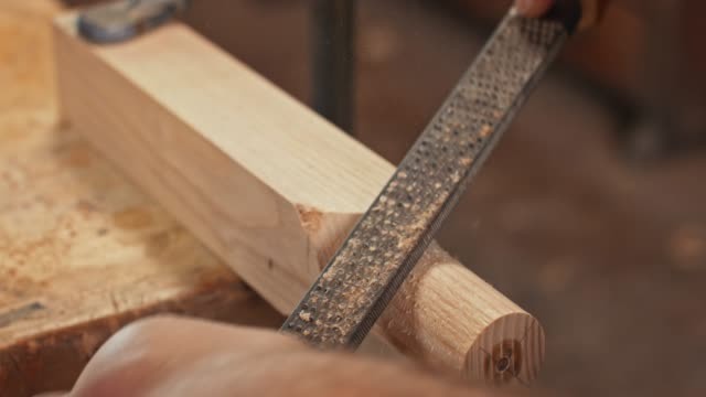 hands of a male carpenter shaping a part of workpiece using a rasp - carving craft product stock videos & royalty-free footage