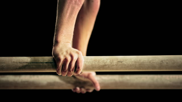 slo mo hands of a male gymnast on the parallel bars - gymnastics bar stock videos & royalty-free footage