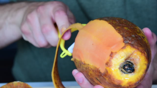hands of a man peeling a papaya fruit - papaya stock videos & royalty-free footage