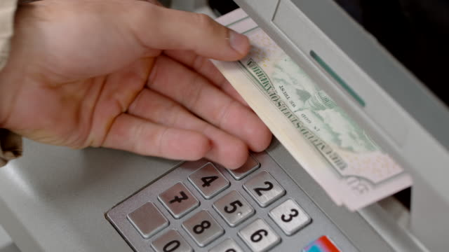 hands of a person making a cash withdrawal at an atm - banknote stock videos & royalty-free footage