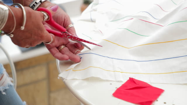 hands of a senior woman cutting some fabric - clothing stock videos & royalty-free footage