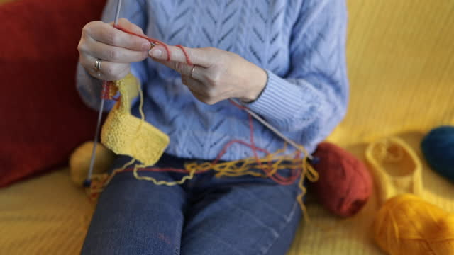 hands of a senior woman knitting. - knitting stock videos & royalty-free footage