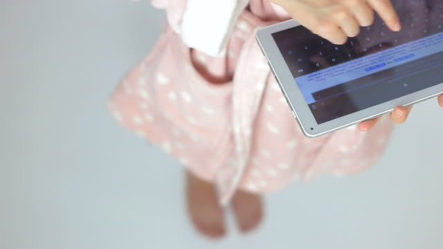hands of a woman browsing on digital tablet. - searching stock videos & royalty-free footage