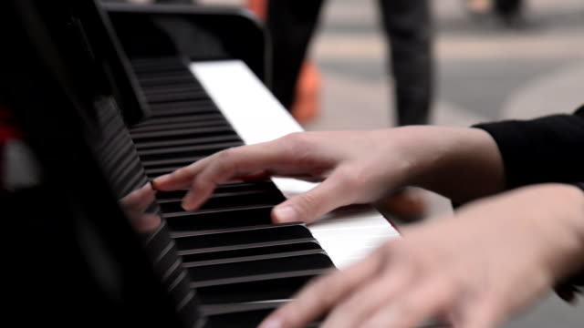 hands of a woman playing the piano / south korea - piano key stock videos & royalty-free footage