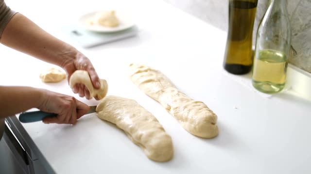 hands of a woman preparing the dough and divides the dough into portions and weights them to make homemade pastry - pastry dough stock videos & royalty-free footage