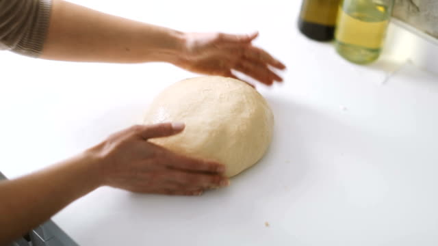 hands of a woman preparing the dough to make homemade bread or pastry - kitchen worktop stock videos & royalty-free footage