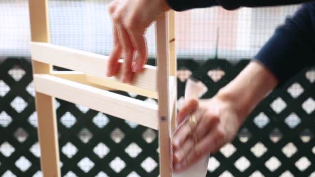 hands of a woman sanding a wooden furniture at home. - sanding stock videos & royalty-free footage