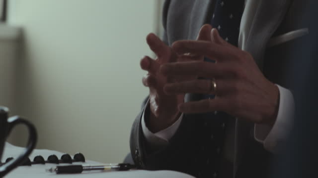 vídeos de stock e filmes b-roll de hands of businessman gesture over notebook. - fato