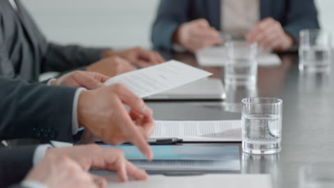 hands of businessman preparing his documents on the conference table before the meeting starts - business meeting stock videos & royalty-free footage