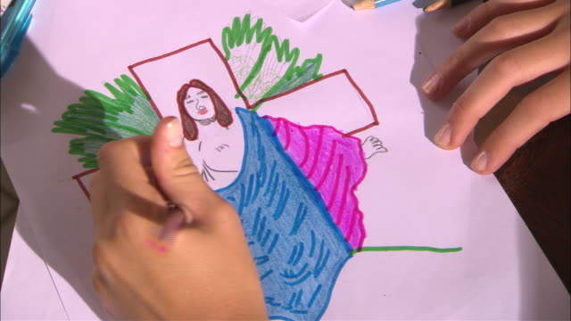 cu hands of child drawing picture of jesus in front of cross with colored pencils/ vila rica do ouro preto, brazil - unknown gender stock videos & royalty-free footage