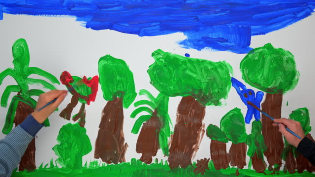 time-lapse hands of children painting a nature scene with trees and animals - holding stock videos & royalty-free footage