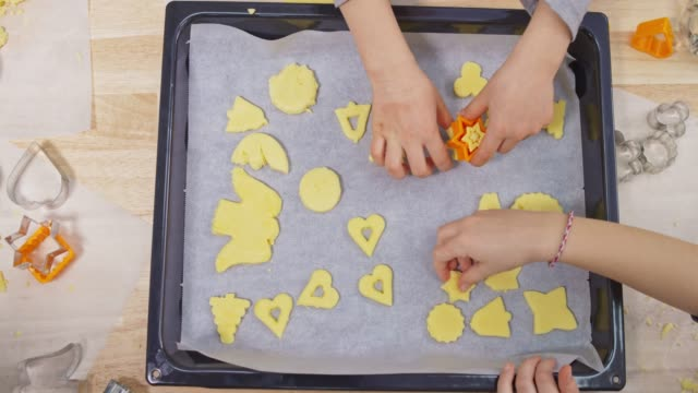hands of children placing cookie dough onto the baking tray - baking tray stock videos & royalty-free footage