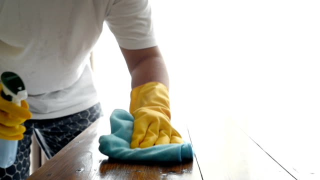hands of cleaner cleaning wooden table by spray and wiping off by microfiber cloth - dishcloth stock videos & royalty-free footage