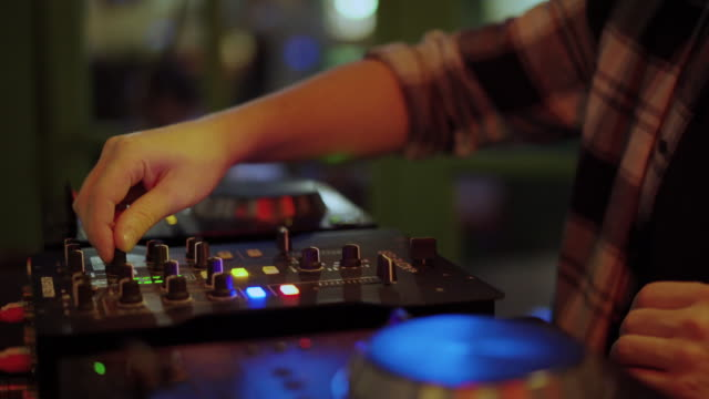 hands of dj tweak turntable mixer console on party in disco club - club dj stock videos & royalty-free footage