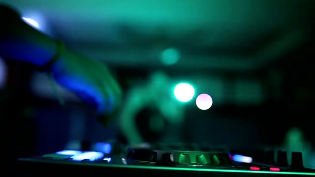 hands of dj tweak various track controls on dj's deck, camera is breathing - disk stock videos & royalty-free footage