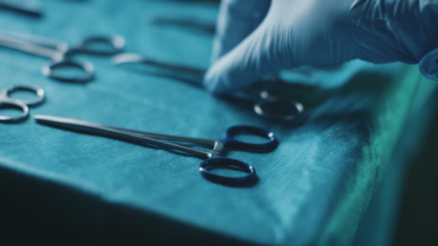 hands of doctor with various surgical equipment - surgeon stock videos & royalty-free footage