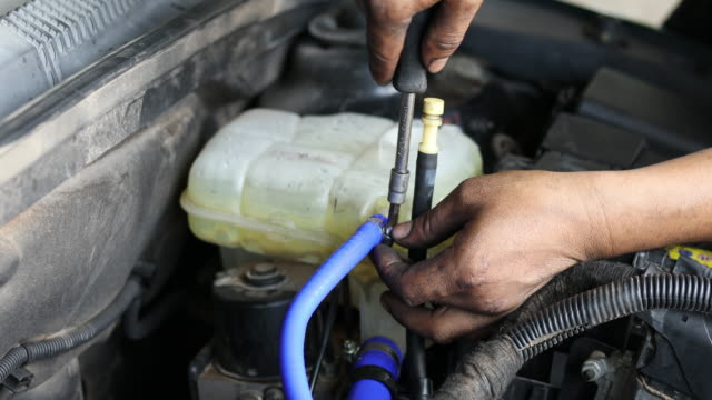 hands of engineering and auto mechanic repairing car - hood clothing stock videos & royalty-free footage