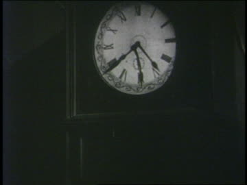 b/w 1929 hands of grandfather clock spinning in all directions - clock face stock videos & royalty-free footage