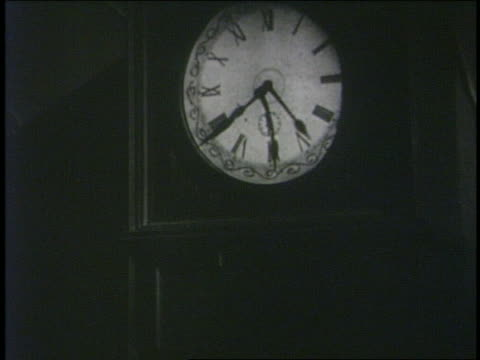 b/w 1929 hands of grandfather clock spinning in all directions - 1920 1929 stock videos & royalty-free footage