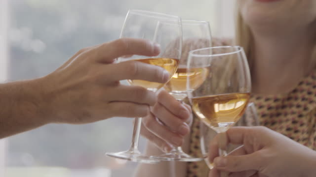cu of hands of group of friends, making a celebratory toast. - celebratory toast stock videos & royalty-free footage