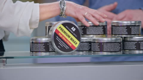 hands of male presenter of the product and female host of the infomercial show talking about the premium car wax product - television advertisement stock videos & royalty-free footage