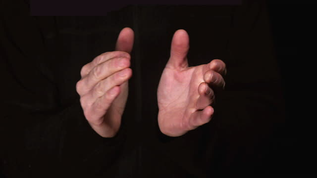 ms slo mo hands of man clapping in dark / vieux pont, normandy, france - applaudire video stock e b–roll