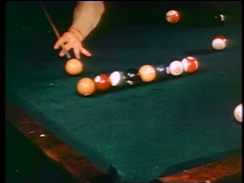 1945 hands of man hitting billiard balls with cue stick / industrial